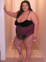 Big boobed playful fatty undressing and teasing in her bed.