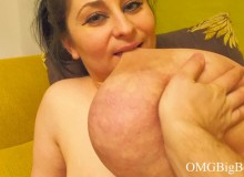 A dude pinching huge breasts and then makes their mistress bite them