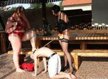 Two fat mistresses having fun with their slave on the dog leash