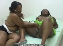 Ebony lesbians with a strap-on