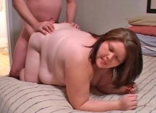 The fatty at this bar party spreads her legs on the couch and the guy fucks her with long strokes