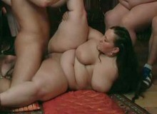 She gives the young guy a great blowjob and then the bbw has him inside her wet cunt